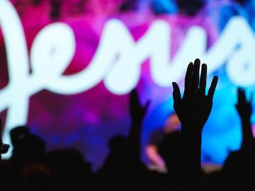 People worshipping in church